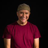 Handsome man. Handsome middle age man wearing a hat on a black background Royalty Free Stock Photo