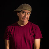 Handsome man. Handsome middle age man wearing a hat on a black background Stock Photo