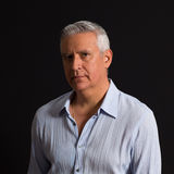 Handsome man. Handsome middle age man on a black background Royalty Free Stock Image