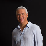 Handsome man. Handsome middle age man on a black background Royalty Free Stock Photos