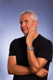 Handsome man. Handsome middle age man in a studio portrait Royalty Free Stock Photography