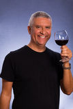 Handsome man. Handsome middle age man in a studio portrait with a glass of red wine Stock Photo