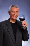 Handsome man. Handsome middle age man in a studio portrait with a glass of red wine Royalty Free Stock Photo