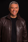 Handsome man. Handsome middle age man in a studio portrait wearing a leather jacket Stock Photography