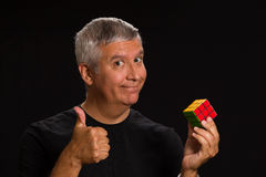 Handsome man. Handsome middle age man in a studio portrait holding a game cube Royalty Free Stock Photography