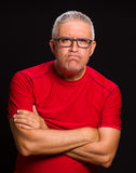 Handsome man. Handsome middle age man portrait on a black background Royalty Free Stock Photos