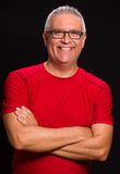 Handsome man. Handsome middle age man portrait on a black background Royalty Free Stock Image
