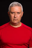 Handsome man. Handsome middle age man portrait on a black background Stock Photo