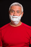 Handsome man. Handsome middle age man with shave cream on a black background Stock Photos