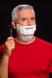 Handsome man. Handsome middle age man with shave cream on a black background Stock Photo