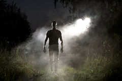 Handsome man and abstract smoke. At night Royalty Free Stock Images