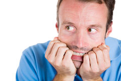 Handsome man afraid and scared and looking at side Royalty Free Stock Images