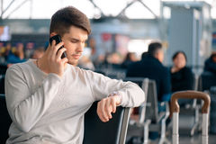 Handsome man in the airport Royalty Free Stock Image