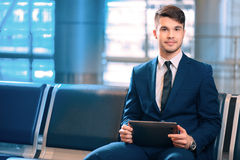 Handsome man in the airport Royalty Free Stock Photos