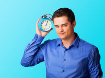 Handsome man with alarm clock Royalty Free Stock Photo