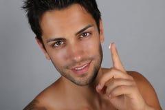 Handsome man applying facial cream Royalty Free Stock Photo