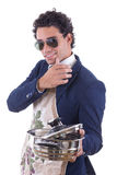 Handsome man with an apron holding a cooking pot Royalty Free Stock Image