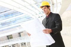 Handsome Man Architect. Attractive young man architect on building construction site royalty free stock photos