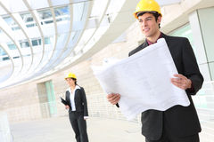 Handsome Man Architect. Attractive young man architect on building construction site royalty free stock image