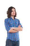 Handsome man with arms crossed looking away. Stock Photography