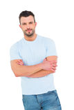 Handsome man with arms crossed Stock Images