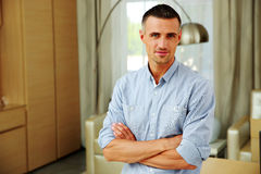 Handsome man with arms folded at home Royalty Free Stock Photography