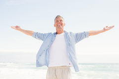 Handsome man with arms outstretched Stock Image