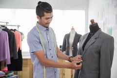 Designer working in his workshop. Handsome man asian fashion designer working in his workshop Royalty Free Stock Photos