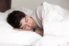 Free Handsome Man Asleep In Bed Wearing Wristband For Sleep Tracking Stock Photo - 90562670