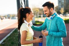 Handsome man and attractive woman talking on court royalty free stock photos