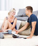 A handsome man with an attractive woman talks. Royalty Free Stock Photo