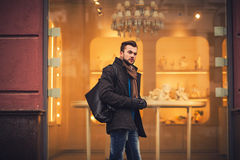 Handsome man with bag in city Royalty Free Stock Photography