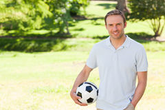 Handsome man with a ball Royalty Free Stock Images