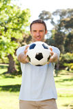 Handsome man with a ball Stock Photography