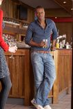 Handsome man in bar Stock Images