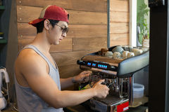 Handsome man barista working make a coffee drink Stock Image