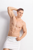 Handsome man with a bath towel around his waist Stock Photo