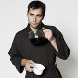 Handsome man in a bathrobe Royalty Free Stock Photography