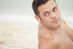 Handsome man on the beach Stock Photography