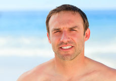 Handsome man on the beach Royalty Free Stock Photos