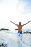 Handsome man on beach Royalty Free Stock Images