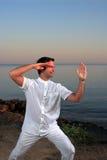Handsome man on the beach meditating Stock Photo