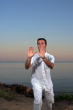 Handsome man on the beach meditating Royalty Free Stock Photography