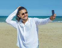 Handsome man on the beach Royalty Free Stock Photography