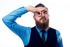 Handsome man with a beard dressed in a blue shirt stock images