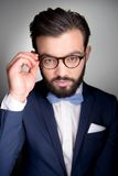 Handsome man with beard and glasses looking at Stock Image