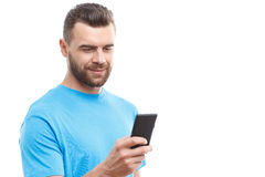 Handsome man with beard holding mobile phone Royalty Free Stock Photos