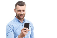 Handsome man with beard holding mobile phone Royalty Free Stock Photography