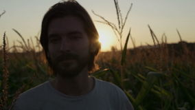 Handsome man with beard with nature landscape in sunset/sunrise. stock footage