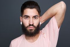 Handsome man with beard and piercings Stock Photos